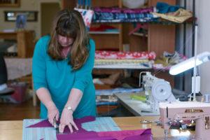 Tori Anna at work making a custom tote bag.