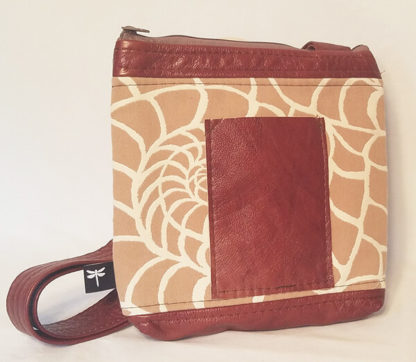 Nautical crossbody bag featuring the tan nautilus pattern with outside pocket by Tori Anna Designs.
