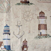 Fabric has a lighthouse pattern on a cream background.